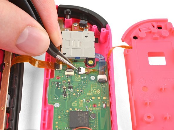 The ZL button cable is locked in place by a small ZIF connector on the motherboard. Use tweezers or a spudger to flip up the ZIF connector lock opposite the cable.