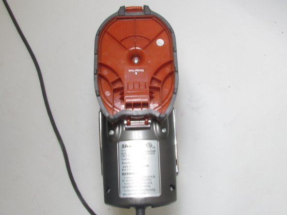 Place the vacuum on the ground with the  filter side away you.