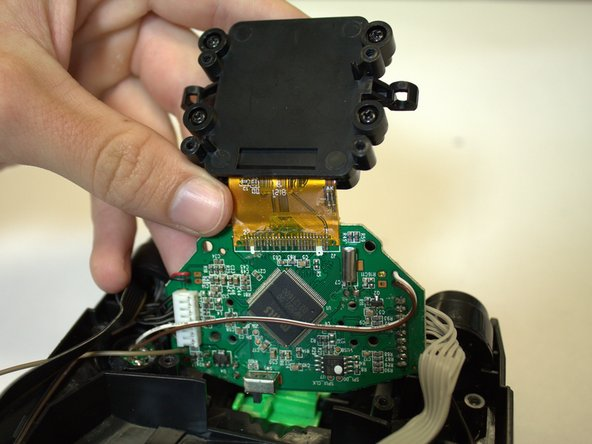 Turn the device around to the other side and lift up the screen assembly.