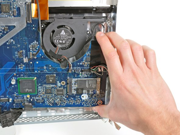 Pull the right edge of the logic board slightly away from the rear case to dislodge the rear I/O ports from their bezel.