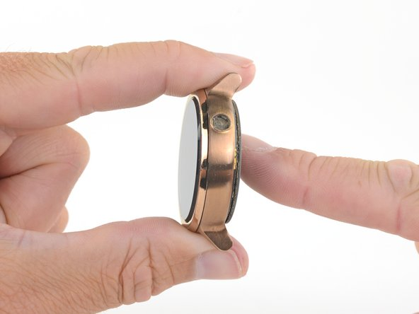 Hold the outer watch case steady and push against the bottom of the inner assembly to remove the inner assembly from the frame.