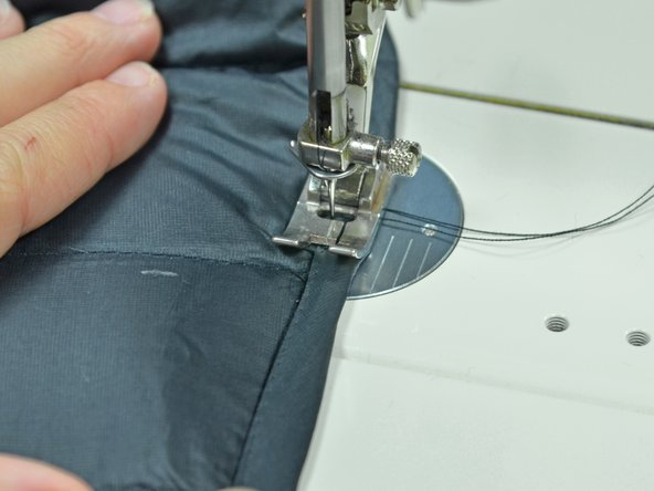 Sew the bias tape back on. Make sure you sew as close to the inside edge of the bias tape as possible.