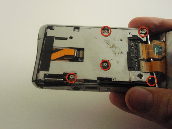 Remove the five screws on the metal plate.
