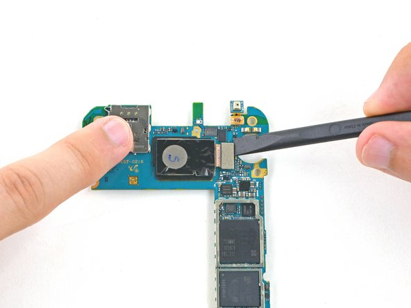 Using a spudger, pry up the connector for the rear facing camera from the motherboard.