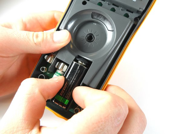 When doing this next step, make sure to remove the battery slowly, so you don't damage the wires connecting the battery to the device.