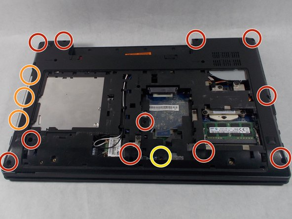 Remove the eleven 2.5 x 6.0 mm Phillips #0 screws.
