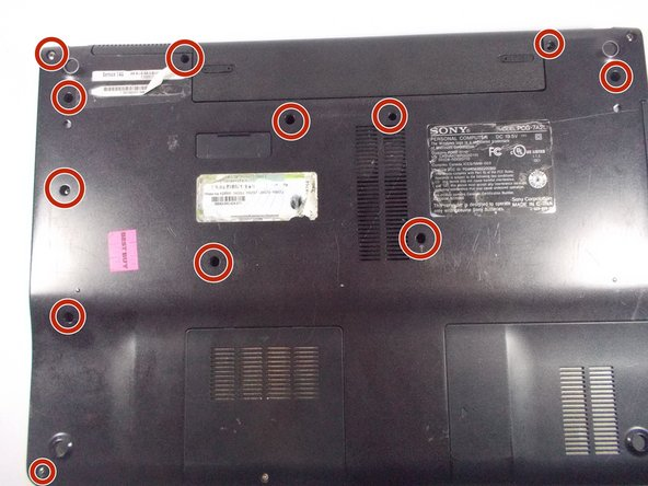 Remove the highlighted screws from the back of the laptop with a Phillips #0 Screwdriver.