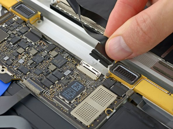 Disconnect the display cable by gently pulling it straight out of its connector.