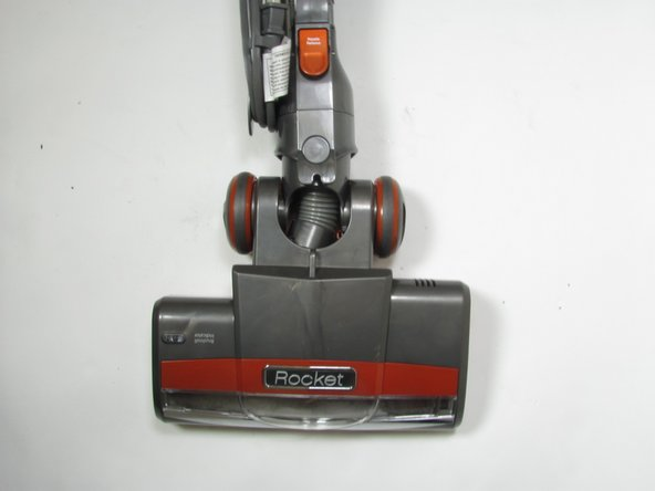 Turn the vacuum over so the rotary brush is on the ground.