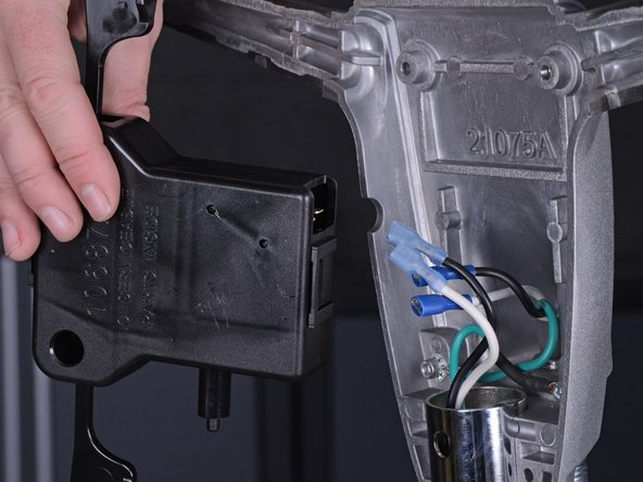 After all wires are disconnected from the interlock assembly, remove the interlock assembly from the handle.
