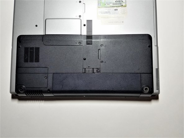 Turn the laptop upside down with the battery compartment facing you.