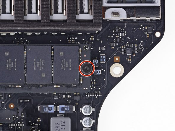 Remove the T8 Torx screw securing the SSD to the logic board.
