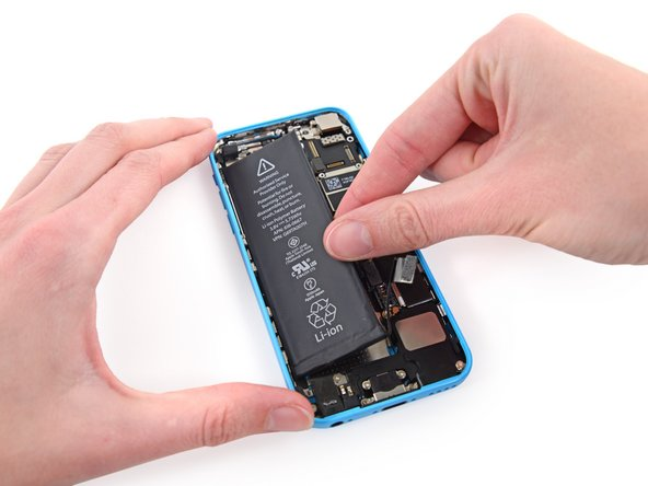 Lift and remove the battery from the iPhone.