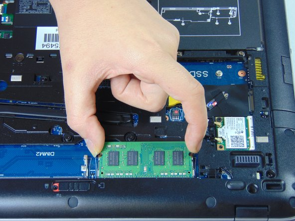 Pull the RAM stick gently out and up once the tabs have been pulled to the side.