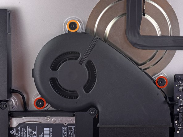 Remove the following screws securing the fan to the rear enclosure:
