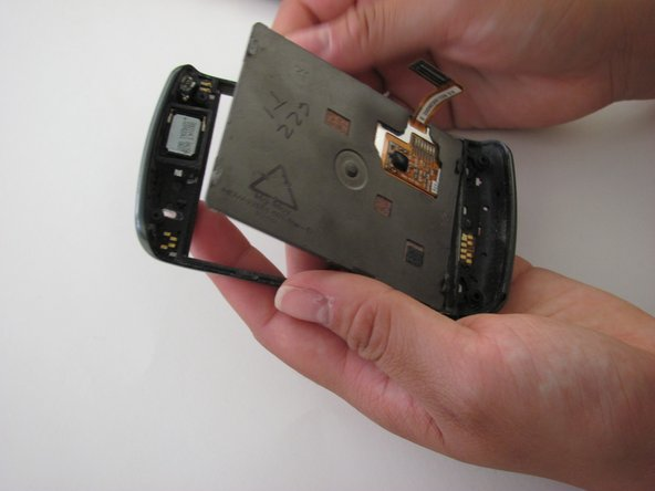 Notice that the LCD/touchscreen is placed directly beneath the side button panel.