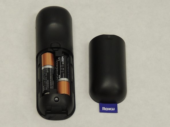 Remove the battery cover to expose the battery compartment.
