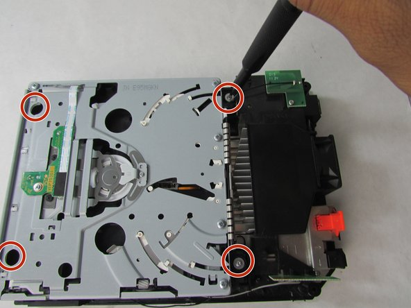 Remove the four 9 mm screws using the Phillips #0 screwdriver.