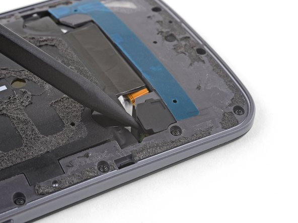 Use the point of a spudger to pry up the rubber cover over the battery connector.