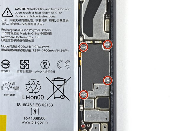 Use a T3 Torx driver to remove the four 3.5 mm screws securing the display connector cover.