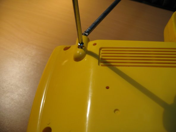 Start with Removing the Antenna by unscrewing the single screw.  Then Unscrew the Seven Screws on the Back of the Radio as indicated in the Photo.  Then remove the handle by simply unscrewing the knob in the middle.