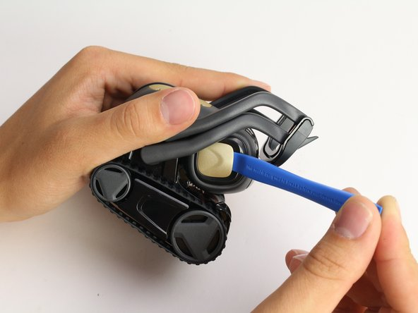 Using the iFixit opening tool, insert the corner under Vector's golden side panel and lightly twist.