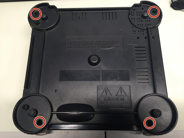 Flip the unit over, so that the bottom side of the case is facing up towards you, exposing the four screws casing screws.