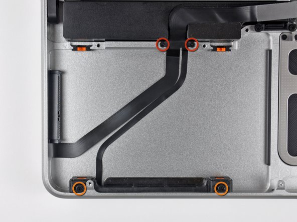 Remove the following four screws securing the hard drive and IR sensor cable to the upper case: