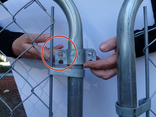 """Using a a 1/2"""" socket wrench or adjustable wrench, bolt the two latch plates on the inside of the gate frame together on  one end."""