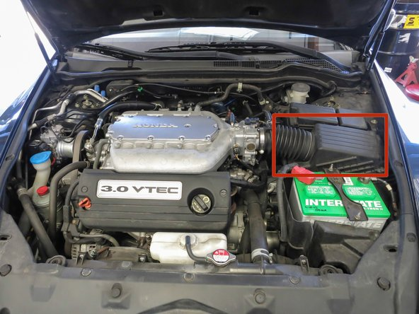 Identify the Air Filter Housing. Located to the right of your engine, this is the black plastic box directly above the battery.