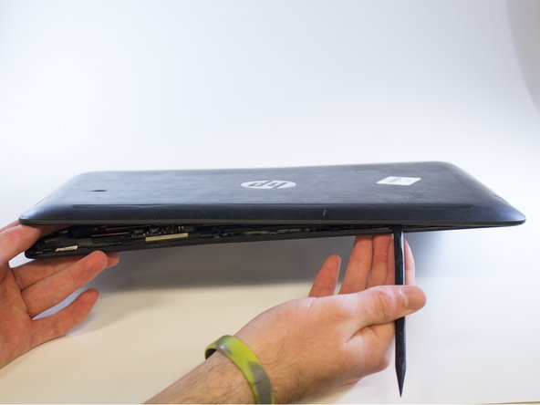 Remove the back of the computer screen by gently using a black nylon spudger.