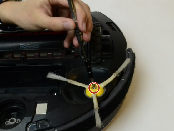Using a Philips #2 Point Screwdriver, remove the screw located in the center of the brush.