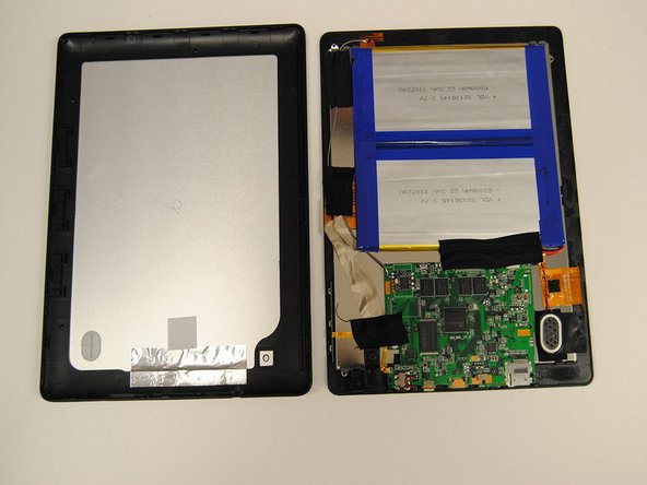 Remove the back cover of the tablet to reveal the internals.