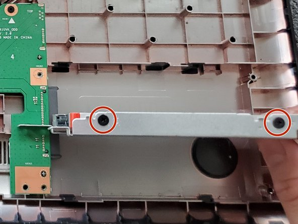 Remove the four 3 mm screws attached to hard drive metal cage using the Phillips #00 screwdriver.