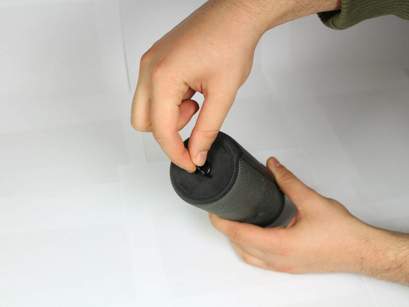 First, remove the D-ring located on the bottom of the UE Boom 2, the opposite end of the power button.
