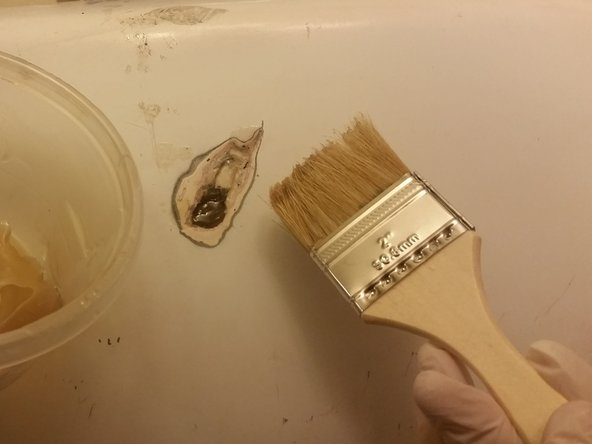 After you have again mixed your resin, begin by applying a small layer to the inside of the hole only.