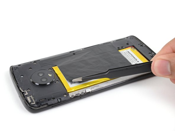 Use a pair of tweezers to carefully peel up the black tape covering the battery.