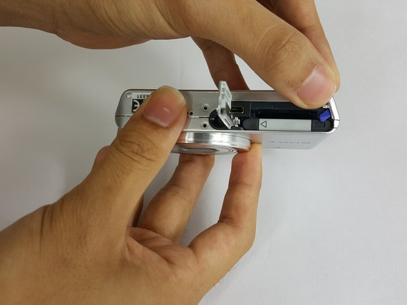 Slide the blue clip up and away from the battery.