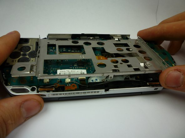 After the screws are removed, the bottom of the LCD frame will rise.