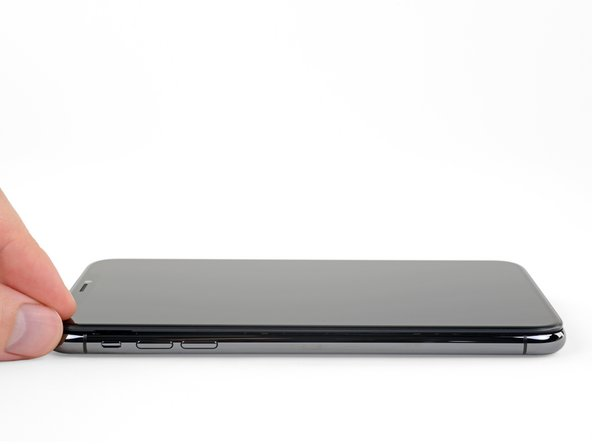 Open the iPhone by swinging the display up from the left side, like the back cover of a book.