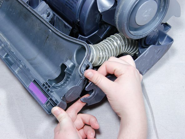 Remove brush-bar housing by prying the housing out of the clips that hold it.