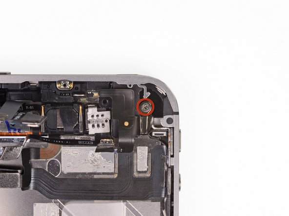 Remove the 2.4 mm Phillips screw next to the headphone jack.