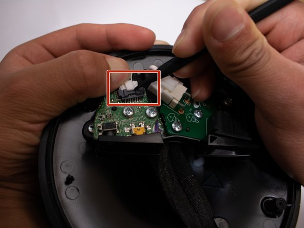 Remove the connector from the board by pressing down on the center tab while nudging the connector away with a spudger.