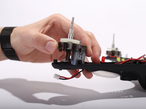 Remove the motor assembly from the bottom shell.