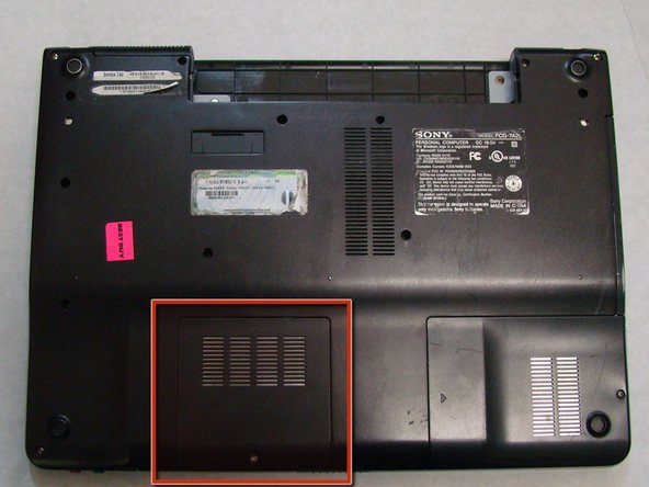 With the bottom of the laptop facing up, locate the RAM cover.