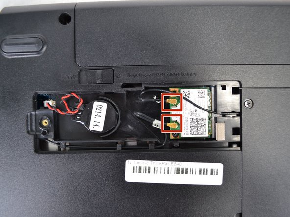 Disconnect the two antenna cables from the wifi card.