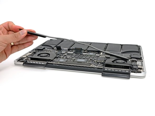 Grasping the heat sink from one side, lift the heat sink off of the MacBook Pro, pulling it free from the computer.