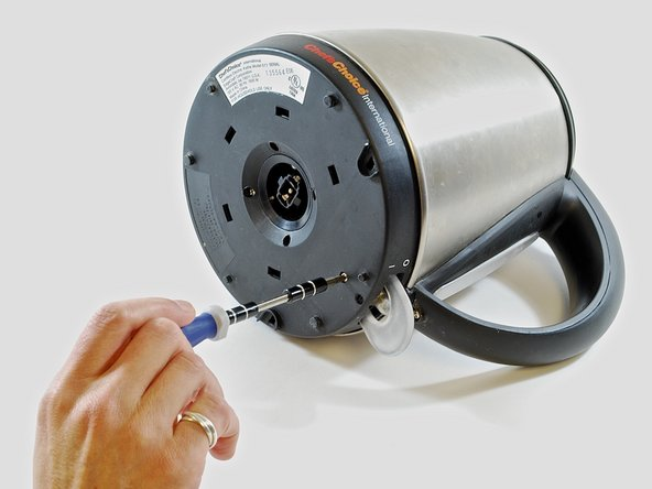 """Remove the five (5) 3/8"""" Phillips screws from the base of the kettle using a #1 Phillips head screwdriver."""