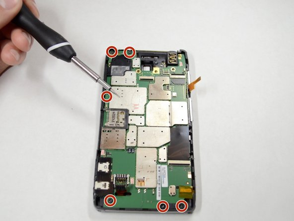 Remove the six 3.5mm Torx T4 screws securing the motherboard to the device frame.