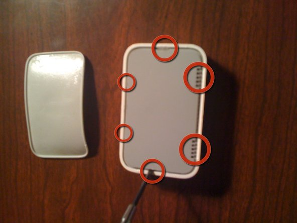 Using a spudger or a flat head screwdriver, release the 6 clips holding the dock to the white plastic molding.